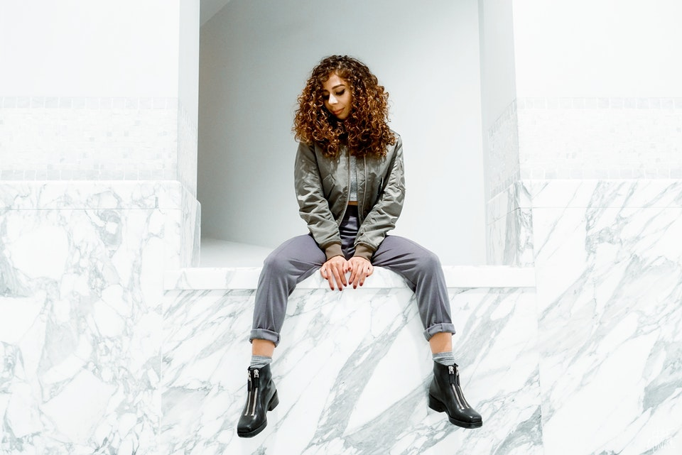 Nina is wearing the Eugene Taylor sharkskin grey joggers   Photo by Clyde Munroe